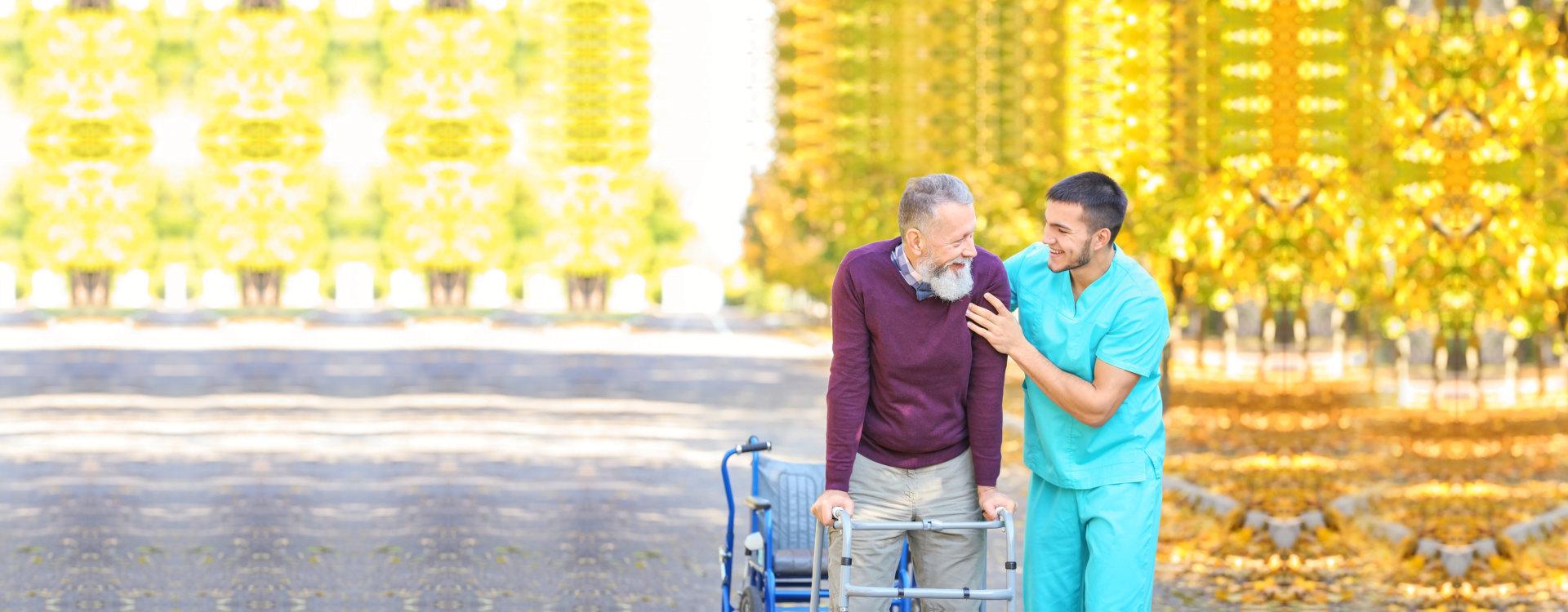man assisting elder man in walking