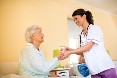 nurse caring an old woman